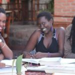 scholarship recipients from open door foundation sit at a table studying for school